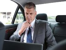 corporate traveler in NH limousine